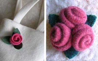 3,再找些绿色的布,剪成叶子状,放在花朵下面,缝好,一朵小花就做好了
