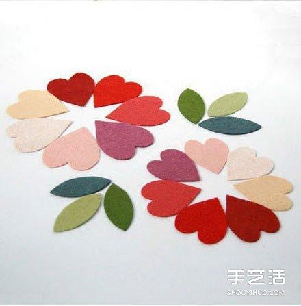 把布片剪成各种花瓣、树叶的形状.   用热熔胶枪粘贴固定到树枝上.  图片