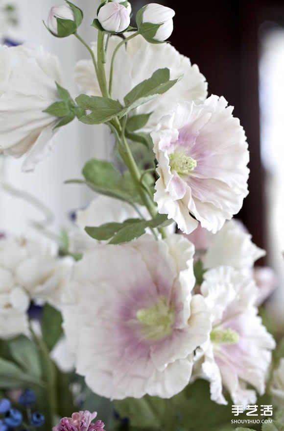 优雅素丽的瓷花雕塑 展现奼紫嫣红的花花世界 -  www.shouyihuo.com