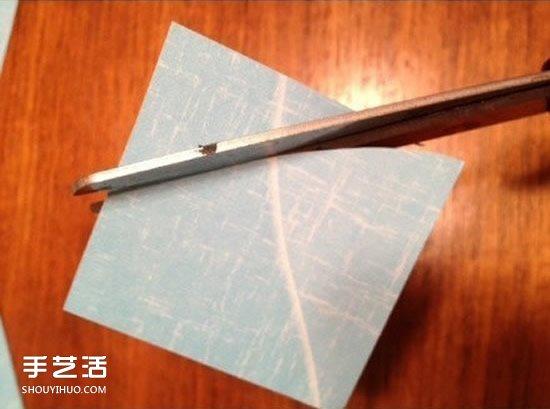 简单又漂亮手工剪纸装饰画的做法图解教程 -  www.shouyihuo.com
