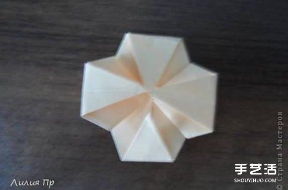手工卡纸折玫瑰花图解 卡纸玫瑰花折纸方法 -  www.shouyihuo.com