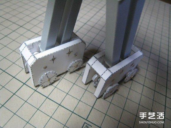 齿轮驱动纸机器人模型 手工自驱动纸机器人图片 -  www.shouyihuo.com
