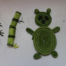 幼儿园小朋友利用水果蔬菜制作的拼贴画图案