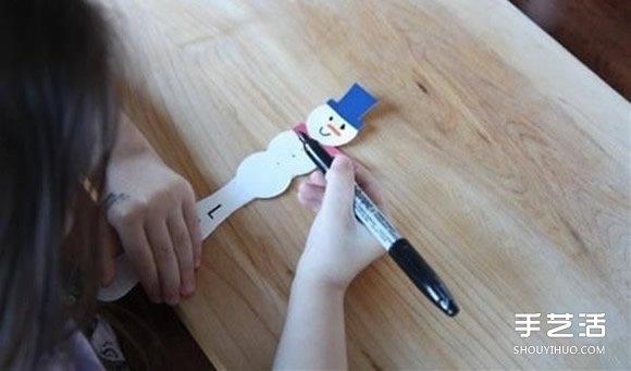 雪人书签制作方法图解 雪糕棍做雪人书签教程 -  www.shouyihuo.com