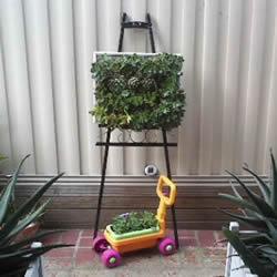 铁架DIY花盆架子图解 旧玩具废物利用做花盆架