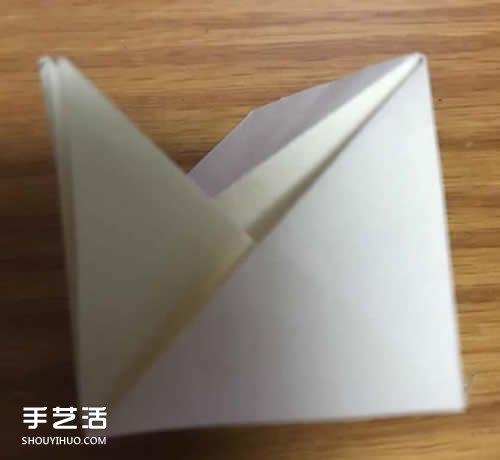 杨桃花怎么折图解教程 手工杨桃花折纸方法 -  www.shouyihuo.com