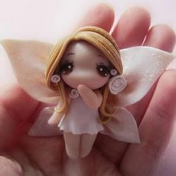 软陶制作小精灵图解 可爱花仙子用软陶做教程