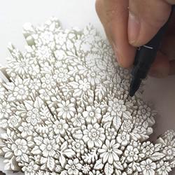 """""""跃""""出纸面的立体画 柬埔寨艺术家的生动涂鸦"""