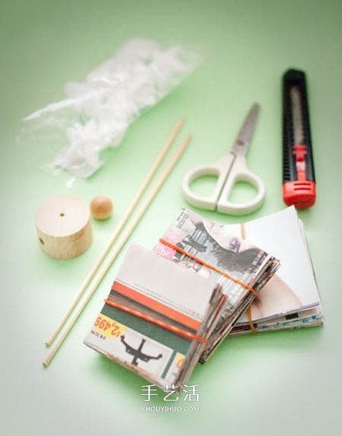 废报纸旧杂志制作圣诞树的方法 简单又漂亮 -  www.shouyihuo.com