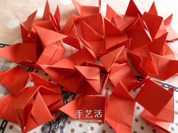 线穿浪漫爱心的折法 创意情人节爱心折纸图解 -  www.shouyihuo.com