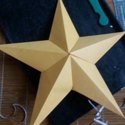 如何用卡纸做五角星 立体五角星的折法图解