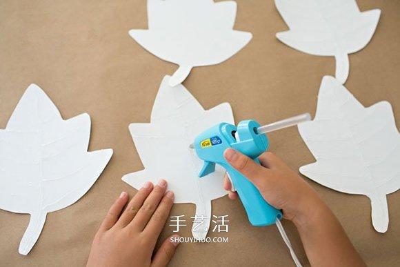 儿童手工做新年挂饰 卡纸枫叶挂饰的做法图解 -  www.shouyihuo.com
