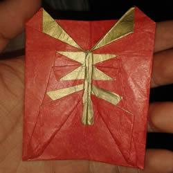 """羊年红包的折法图解 折出一个带""""羊""""字的红包"""