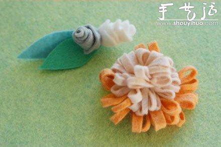 手工布藝製作帶綠葉的花朵