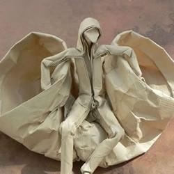 复杂人物折纸作品欣赏——穿风衣的小人