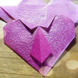 领带爱心的折法图解 漂亮领带心的折纸教