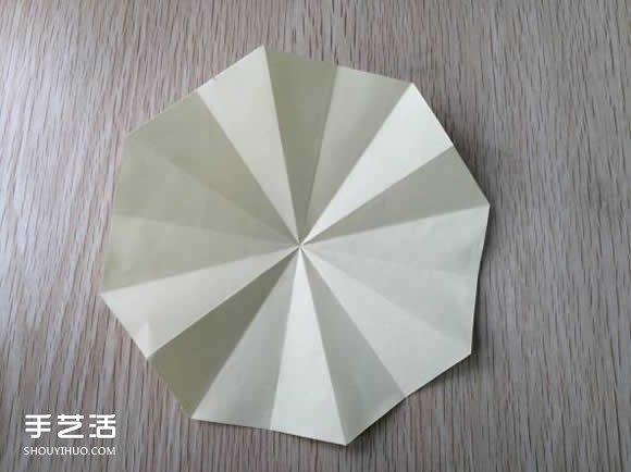 八瓣花的折法图解教程 折纸八瓣花的过程步骤 -  www.shouyihuo.com