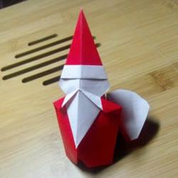 背着麻袋的可爱圣诞老人手工折纸图解教程