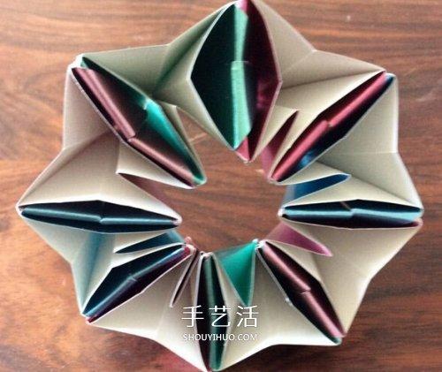多张纸折花的方法图解 立体八瓣花的折法步骤 -  www.shouyihuo.com