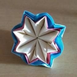 怎么折漂亮纸花 手工折纸八角星花的折法