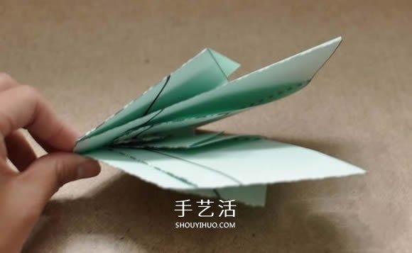 一张纸只剪一刀就剪出天鹅的折叠剪纸教程 -  www.shouyihuo.com