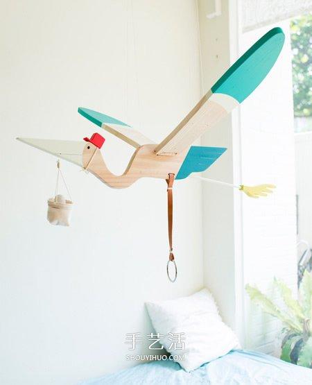 手工制作木头玩具送子鸟 拉下拉环扇动翅膀飞行 -  www.shouyihuo.com