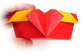 带爱心纸盒子的折法 有四个心形收纳盒的折法 -  www.shouyihuo.com