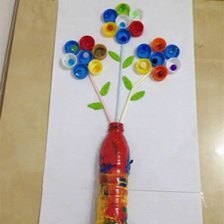 幼儿园瓶盖小制作 用瓶盖拼贴美丽的插花画