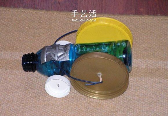 酸奶盒废物利用制作橡皮筋动力回力车的方法 -  www.shouyihuo.com