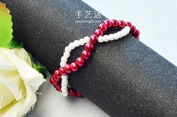 自制红白两色华丽珍珠手链的方法图解 -  www.shouyihuo.com