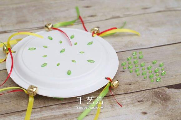 自制纸盘手鼓的方法简单又可爱 -  www.shouyihuo.com