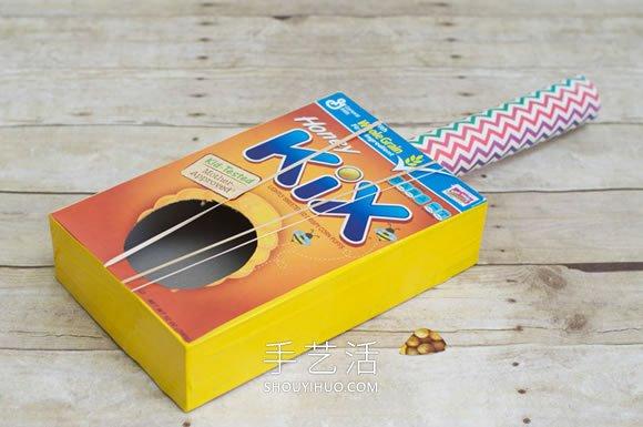 纸盒废物利用小制作 自制儿童吉他的方法教程 -  www.shouyihuo.com