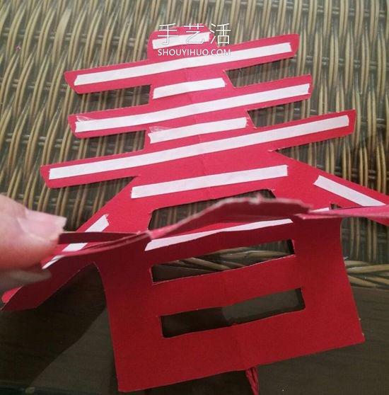 剪纸制作过年时春字挂饰的做法教程 -  www.mutamen.cn