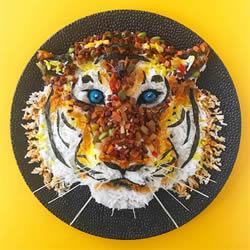 食品造型师精心制作美味的可食用菜肴摆盘
