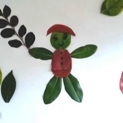 树叶粘贴画简易人物的过程图片