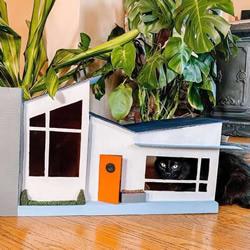 她为两只猫手工制作一座中世纪风格的纸板屋