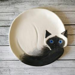 受到猫咪睡眠姿势的启发,手工创意陶瓷猫碟