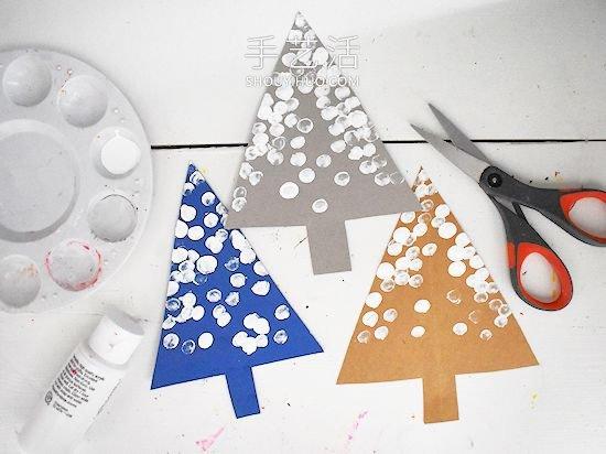 幼儿园手工制作被雪覆盖的树木 -  www.shouyihuo.com